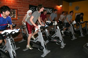 Members of the Grinnell Men's Golf team works hard during a spinning class at Fly High Fitness Studio on Tuesday getting in shape for the spring season. - Michelle Fournier