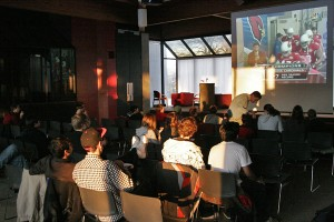 Grinnellians watch Superbowl XLIII on Sunday evening in the Forum South Lounge. While the official party was in the Forum, many students packed lounges across campus to watch the Pittsburgh Steelers pull off a 27-23 victory over the Arizona Cardinals. - Aaron Barker