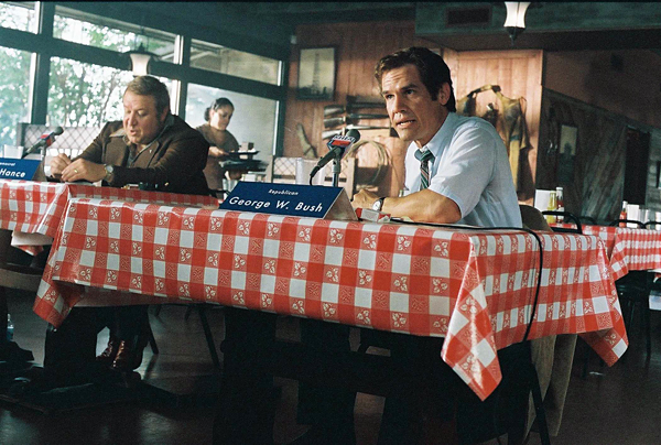 Josh Brolin (right) gives a wonderful performance of our most widely hated recent president. - www.AllMoviePhotos.com