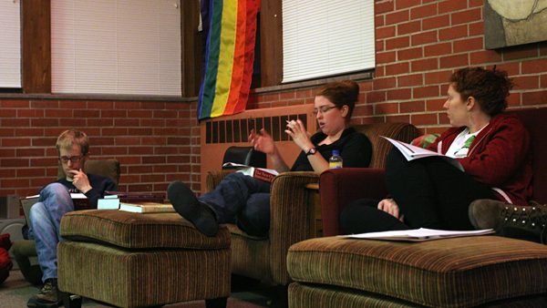 In the Stonewall Resource Center, students Jon Richardson ('10) and Leah Krandel ('09) take part in the bible discussion led by Lily Fellow in Religious Studies, Katie Snipes. - Paul Kramer