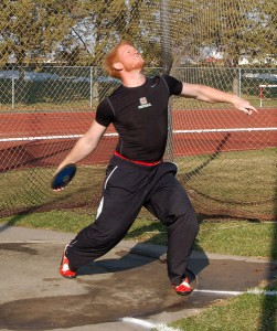 Curtis McCoy '10 winds up and throws the discus during Monday's practice out at Les Duke track. - Sophie Fajardo
