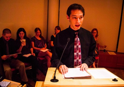 Logan Shearer '13.5 reading the translated Beowulf to the audience. Photo by Saw Min Maw.