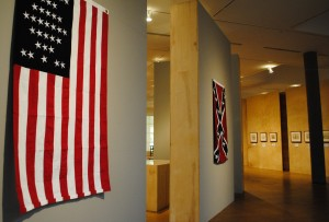 Union and Confederate flags hang in Faulconer Gallery.  They are exhibited along with Civil War Era Drawings from the Becker Collection. Photo by Connie Lee.