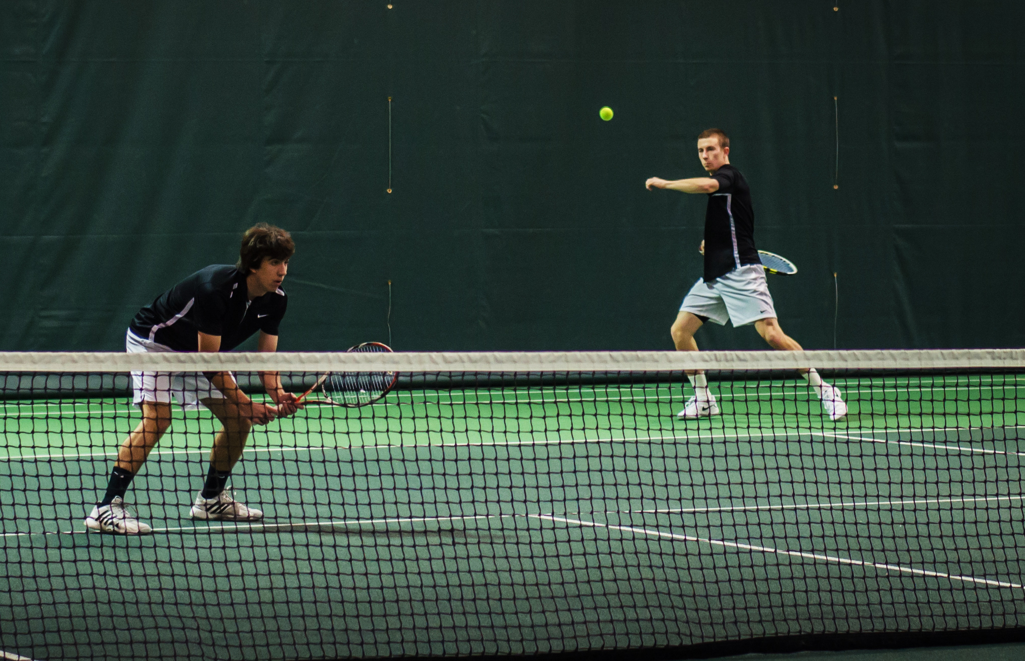 Ben Charney '15 and Rob Storrick '15 play doubles at the tourney against Wartburg on Sunday morning. Photograph by John Brady.