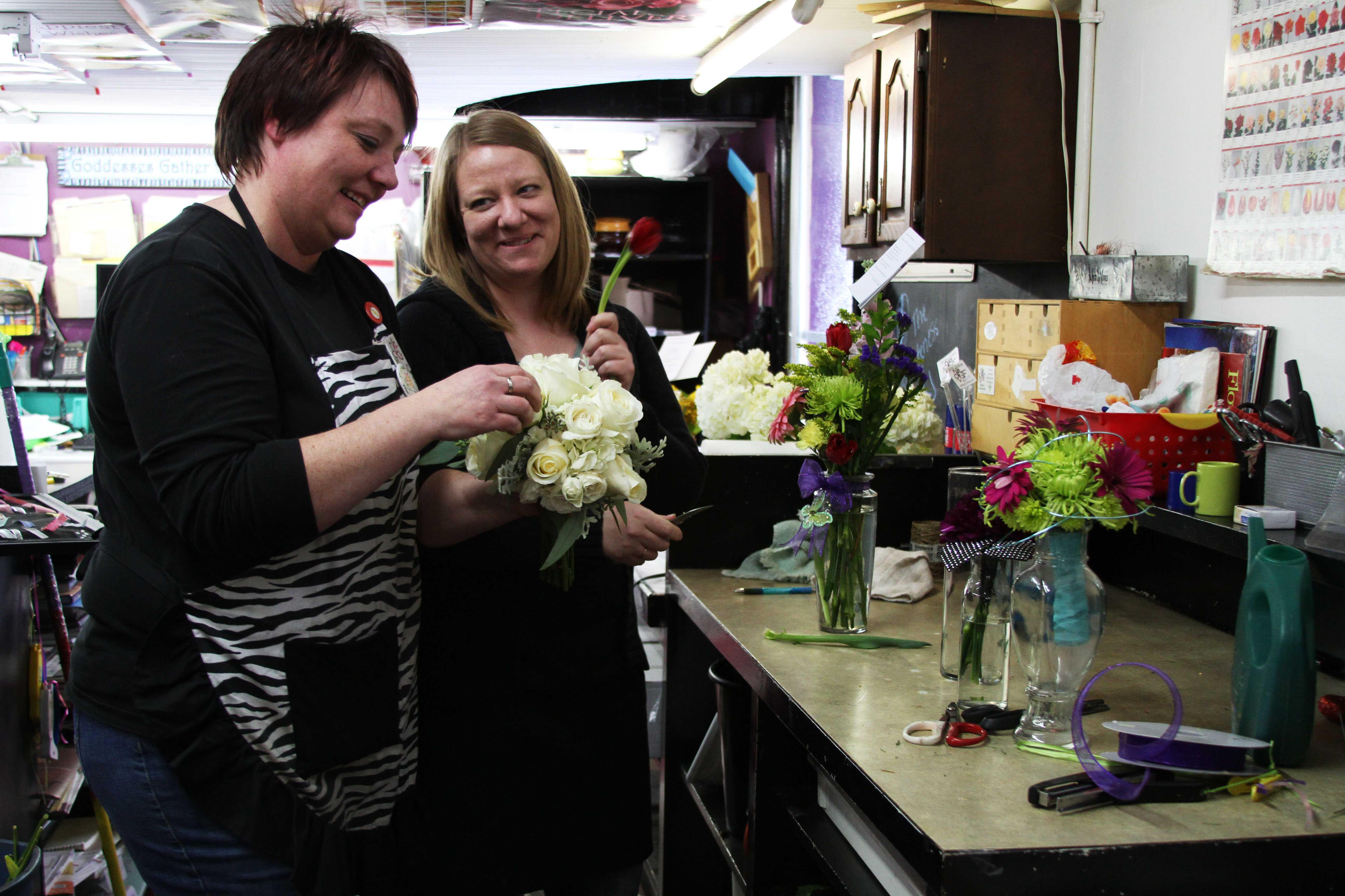 Jody Fairchild-VanDeKrol (right) and sister Charity Fairchild-Kirsch work on a floral arrangement. Photo by Avery Rowlison.