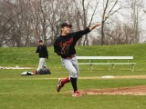Andrew Platt '13 pitches during practice.
