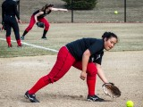 Jeanette Au '16 catches a grounder during practice Thursday. Photo by John Brady