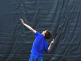 Colin Johnson '13 serves the ball during practice this week.