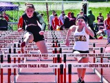 Nora Brusette Buccino '16 competes in the hurdles Saturday at Central in Pella.  Photo by Alysia Horcher
