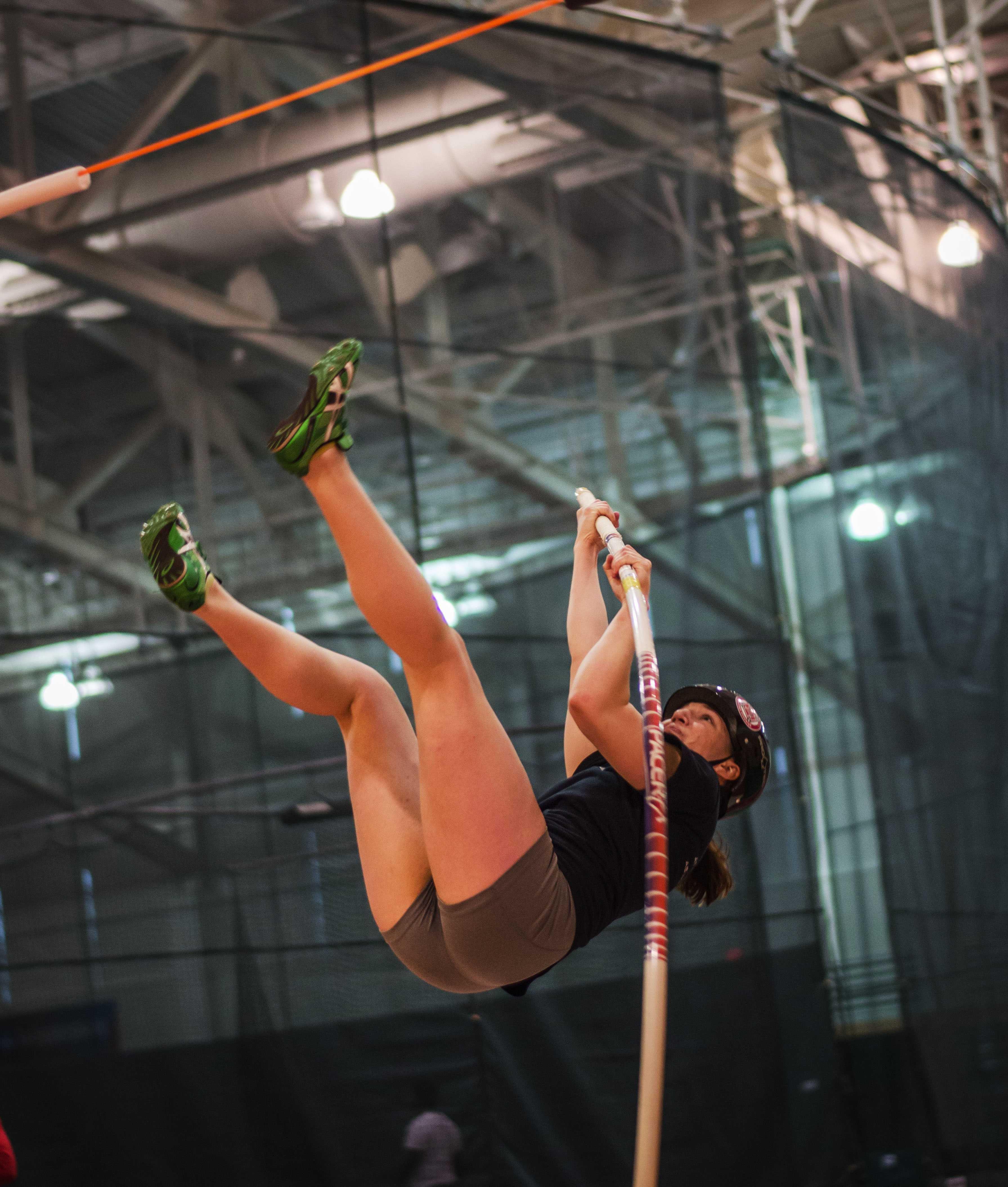 Athena Carlson '15 pole vaults at practice this week. Photo by John Brady