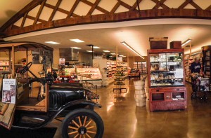 The new interior of McNally's features antique trusses and a vintage Model-T, reflecting the original 1920s Ford dealership it now inhabits.