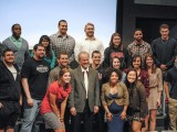 Human rights activist Richard Lapchick poses with students in Harris on Tuesday. Photo by Connie Lee.