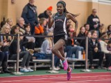 After tying her school record in the 400-meter dash, Christine Ajinjeru '14 hopes to qualify for Drake Relays. Photo by John Brady.