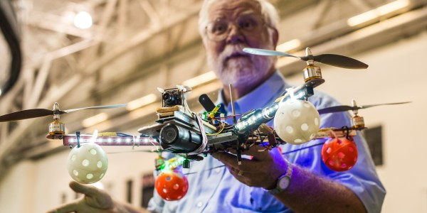 Automation expert Thomas Kaminski shows Grinnellians a model drone in the Bear Recreation Center.   Photo by John Brady