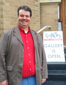 Christian Lutz smiles outside the Grinnell Arts Center Gallery. Photo contributed.