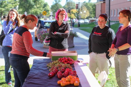 Students stop for free fruit outside Noyce Science Center. Photo by Aaron Juarez.
