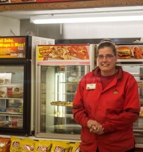 Stephanie Dillon, the manager at a Casey's General Store, poses for a photo at work. Photo by Ying Long.