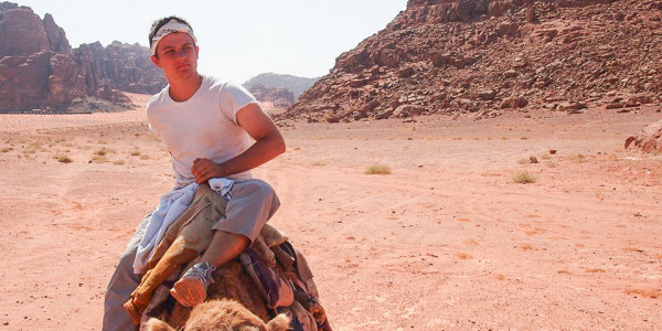 Sam Curry '16 sits atop a camel in Amman, Jordan during his study abroad program last fall. Photo contributed