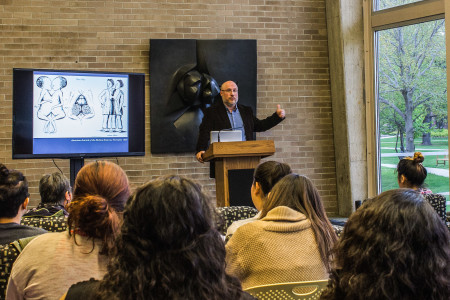 As part of APIA week, Joe Orser, a Professor of History at U of WI - Eau Claire, discusses his book about historical Siamese twins on Tuesday, April 28, in Burling Lounge. Photo by Rae Kuhlman.