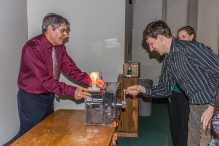 Richard Wolfson demonstrates the quantity of energy in use through a lightbulb experiment.  Photo by Sarah Ruiz.
