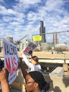 Taylor Burton '18 and Cecilia Kwakye '17 participate in a march for workers' rights in Chicago. Photo contributed