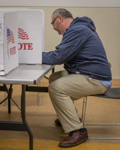 Voters cast their votes on the referendum at the Drake Community Library on Tuesday, April 7. Photo by  Chris Lee.