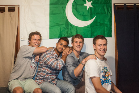 From left: Teammates Bryson Cale, Ameer Shujjah, Tracy Johnson, and CJ Ray (all '16) in front of the Pakistani flag. (Photo by Tela Ebersole)