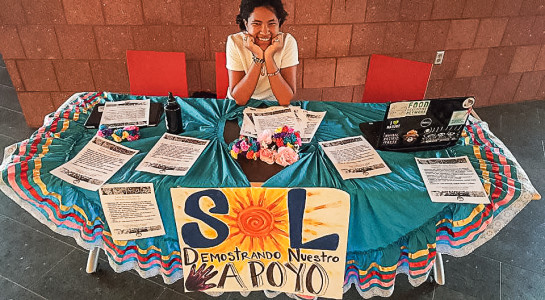 Glorianne Dorce '17 publicizes in front of the Dining Hall for events held during National Hispanic Heritage Month. (Photo contributed)