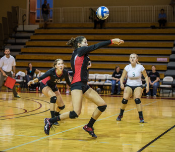 Margret Giles '18  (center) in action versus Central College on Thursday, Sep. 17. while Olivia Fromm '17 (left) and Sydney Vrecenar '18 (right) look on.  Photo by John Brady