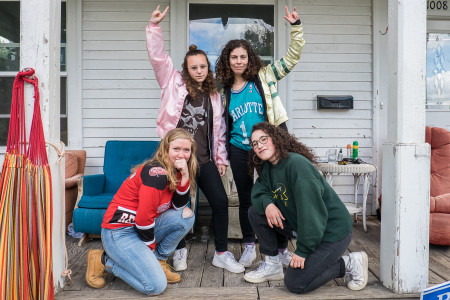 From left: Anna Transit, Jenny Samuels, Eliza Harrison and Sophie Donlon (all '16) pose on their trademark front porch. (Photo by Takahiro Omura)