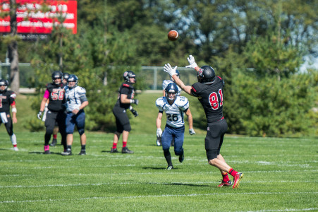 Henry Cummings '16 catches a 67-yard pass for a touchdown Saturday.   Photo by John Brady