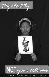 Gigi Dorce '17 poses in a poster speaking against the cultural appropriation of Halloween costumes. (Photo contributed)