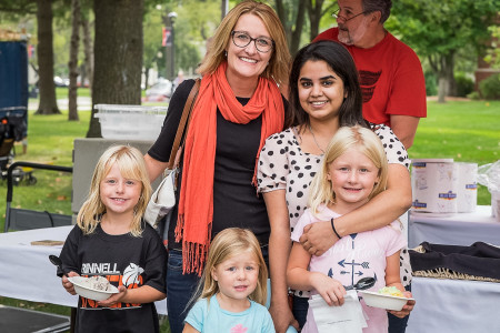 Avantika Johri '18 (upper right) poses with her host family at the ice cream social during Family Weekend. (Photo Contributed)