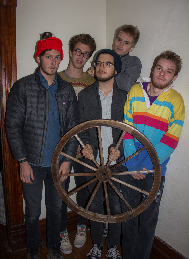Clockwise from top left: Cal Froikin, Ezra Edgerton, Jack Dunnington, Mark Spero and Nick Matesanz, all '16,  pose behind one of the curious objects in Bean World. Photo by Sarah Ruiz.
