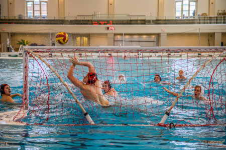 Zach Laird '17 making a save for the Wild Turkeys, Grinnell's water polo club team, that is among the best in the nation.  Photo by Jun Taek Lee