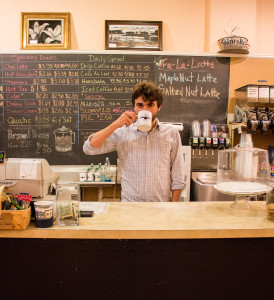 The S&B coffee expert and barista Sam Catanzaro '16 takes a sip of a cup of Joe behind their counter. (Photo by Sarah Ruiz.)