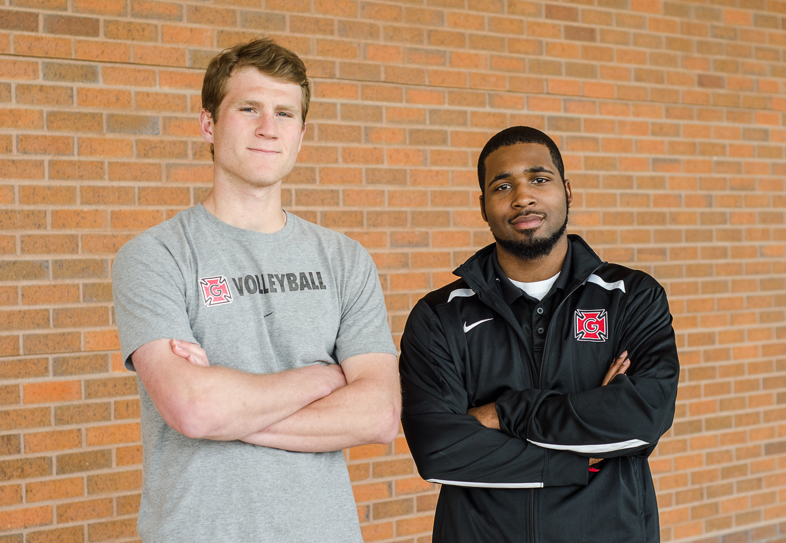 Tracy Johnson '16 and Jermaine Marks '17 rep for the teams they manage: volleyball and basketball, respectively. Photo by Ellen Schoenmaker