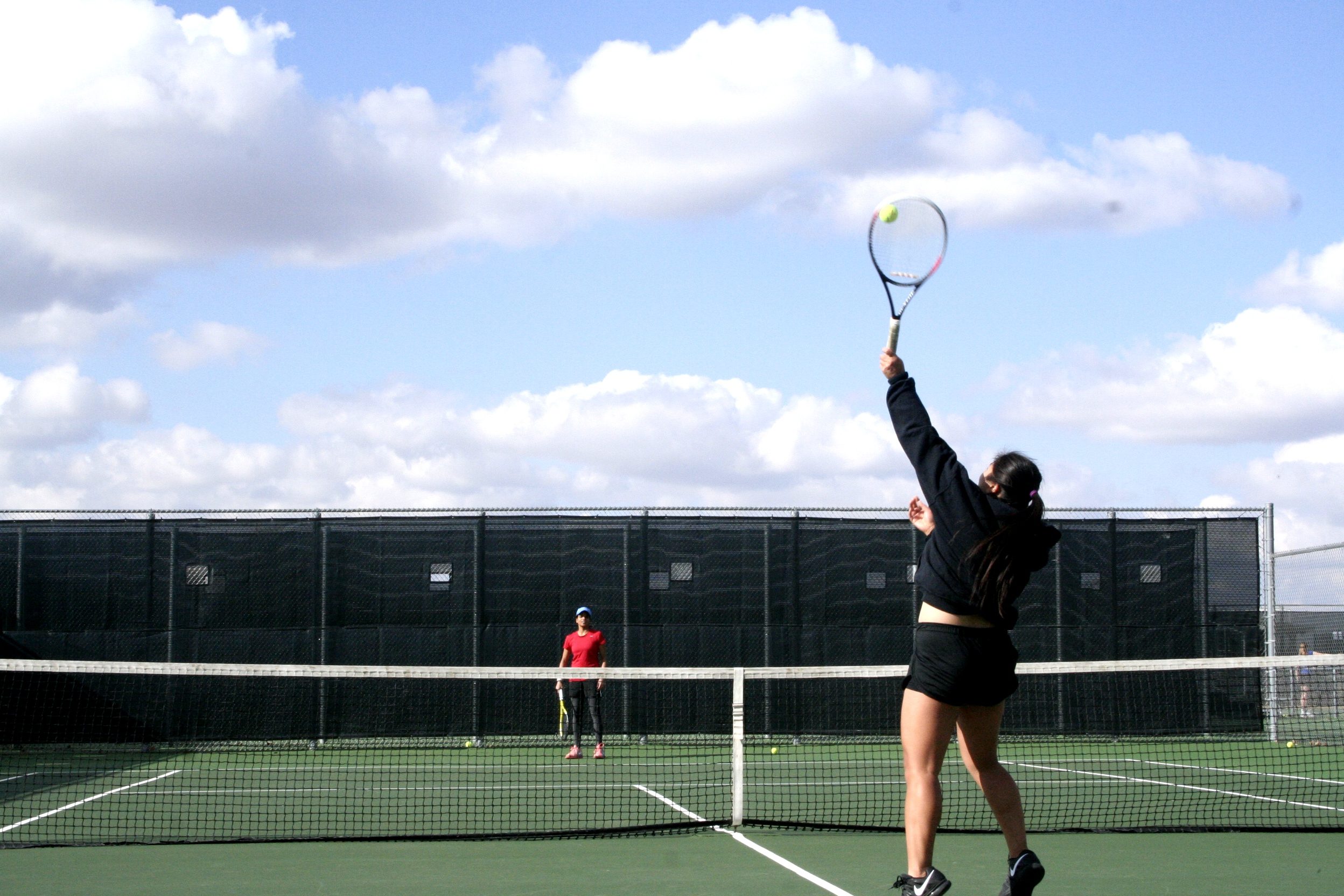Women's tennis serves up some wins against Central College and Simpson College. Photo by Jenny Dong.