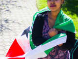 Deqa Aden is fundraising for drought alleviation efforts in Somaliland, whose flag she is pictured holding.  Photo by Misha Gelnarova.