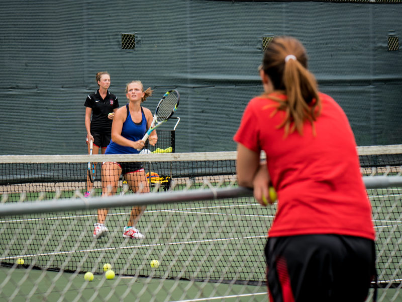 The women's tennis team practices on Wednesday before their next match against the University of Wisconsin-Whitewater.  Photo by Xiaoxuan Yang.
