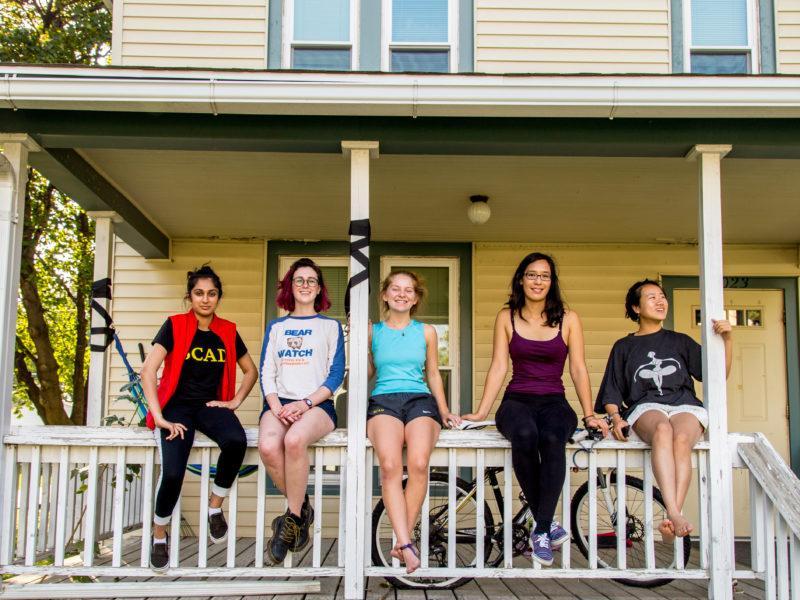 Radhika Malaviya '18, Anna Warm '19, Vivian Cheslack '19, Leina'ala Voss '18 and Jinlin He '18 sit on the porch of Art House, a new project house. Photo by Garrett Wang.