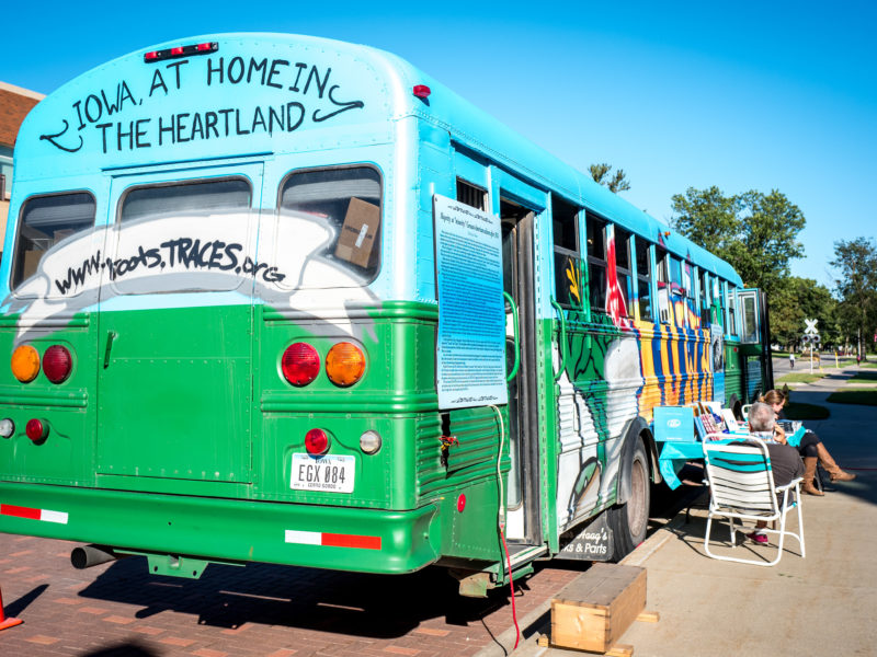 """The bus for """"A Home in the Heartland: Forgotten Stories of how Iowa Got to Be 'Us'"""" is painted differently than the four exhibits TRACES has run previously. The organization has driven Iowa's social history around the Midwest. Photo by Xiaoxuan Yang."""