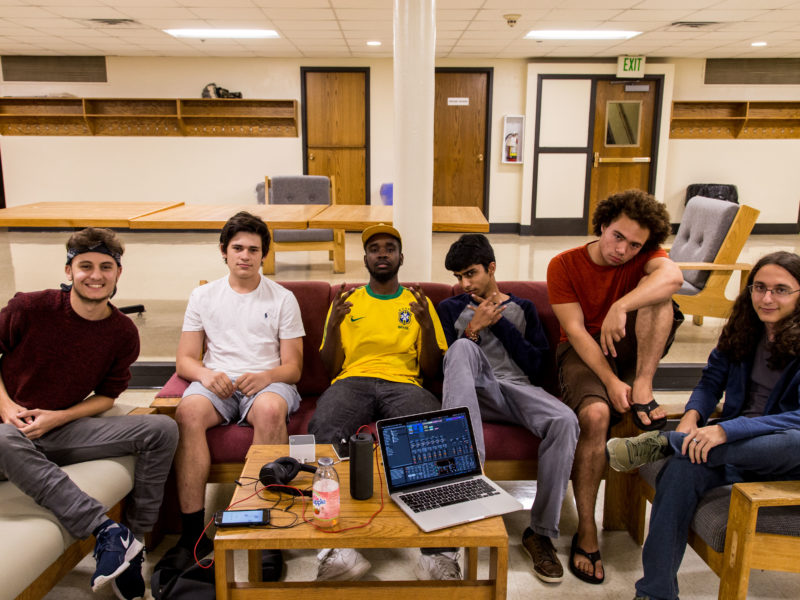 Photo by Garrett Wang. Reed Essex '19, Jacob Leder '20, Hameed Weaver '17, Dhruv Gupta '17, Logan Stuart '19 and Deniz Sahin '20 come together to share homemade beats and practice freestyling. A performance is coming up soon.