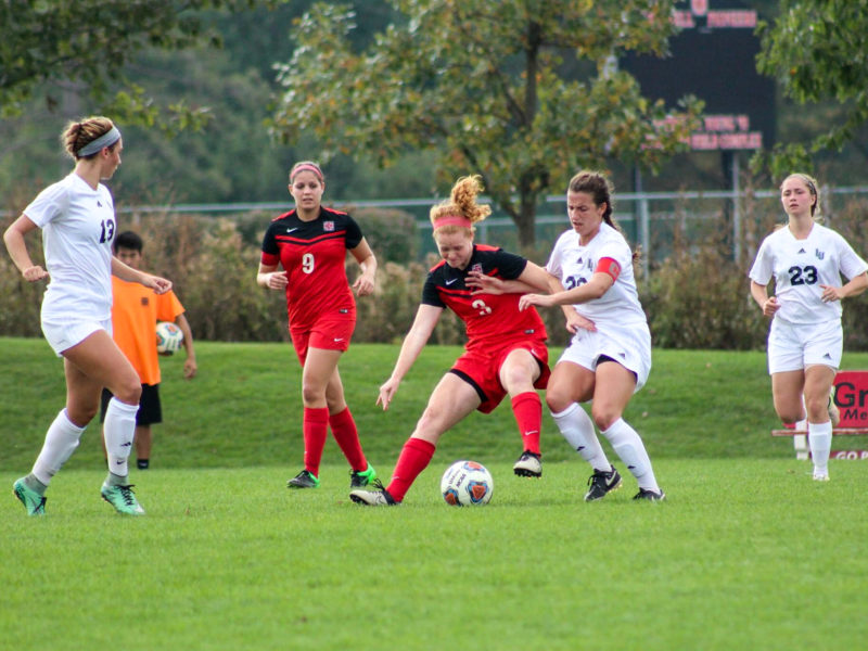 Midfielder Lauren Hurley  18 fights hard fo rthe ball during a match over fall break. Photo contributed.