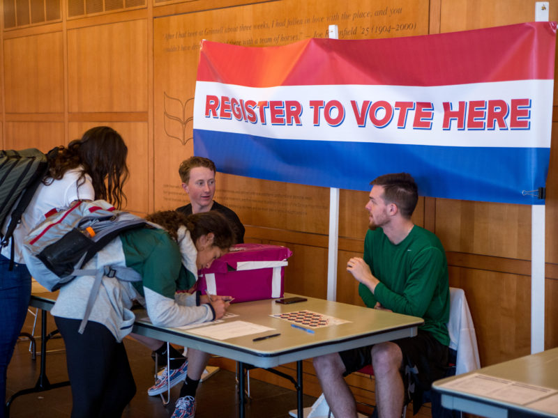 jeff li  Students register others to vote outside of the Spencer Grill in the JRC.