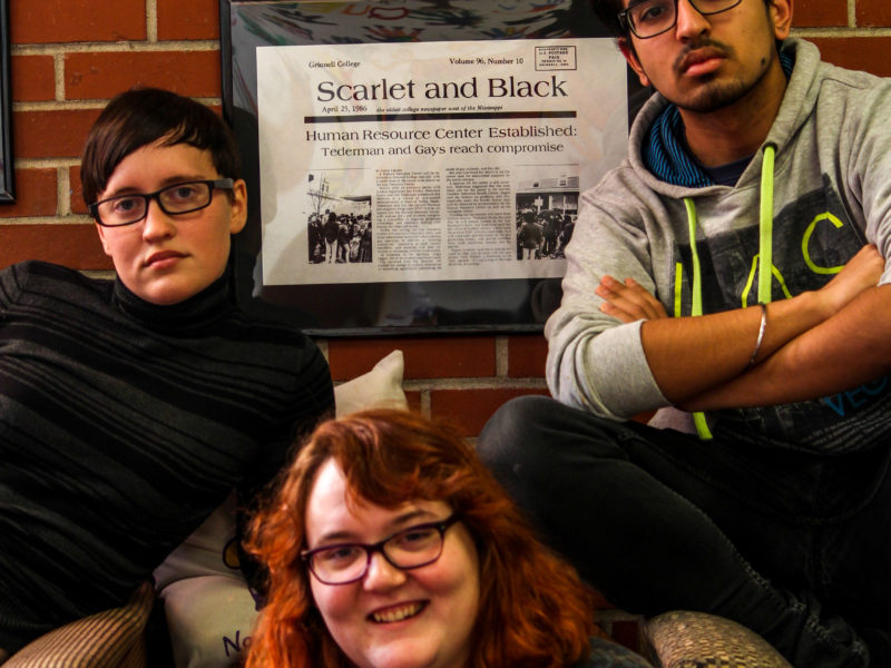 Magyar '17, Lily Galloway '17 and Takshil Sachdev '19 pose in front of the front page of The S&B from 30 years ago when the SRC was started. Photo by Jenny Dong.