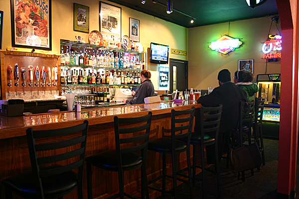 Customers sit at teh bar of the new Lonnski's which opened on January 25th at 910 Main Street. The new location features a pool table, darts, an expanded menu and more beers on tap. - Cait De Mott Grady