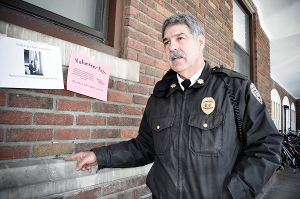 """You just have to follow your nose,"" says Campus Security officer Russ Motta as he points to the evidence that he sniffed out: a burned mark on Cleveland's exterior and culprit cigarette above it. - Sophie Fajardo"